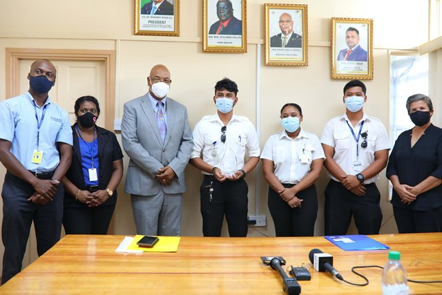 Minister of Public Works, Hon. Bishop Juan Edghill, Captain Azam Ally and other officials from Air Services Limited. Mr. Leslie Johnson is also pictured first, left.