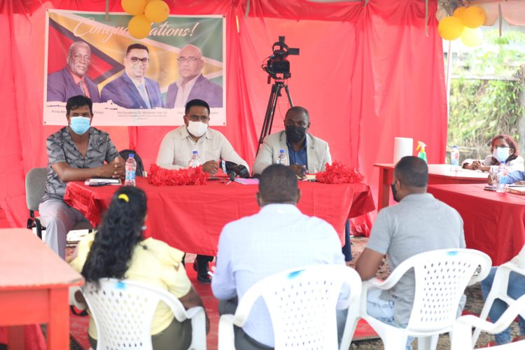 Minister within the Office of the Prime Minister, Hon. Kwame McCoy and Minister of Local Government and Regional Development, Hon. Nigel Dharamlall engaging another group of residents