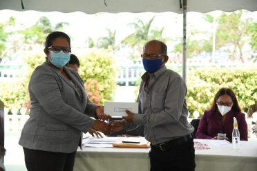 Region Two Regional Chairman, Ms. Vilma DaSilva presents the grant to Mr. Ralph Hendricks of Capoey