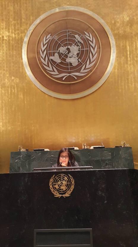 Shatha strikes a pose at the GA podium
