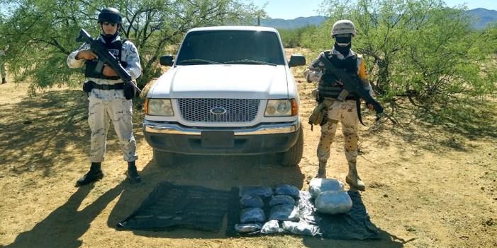 Guardia Nacional y Sedena aseguran armas, municiones, opio y marihuana
