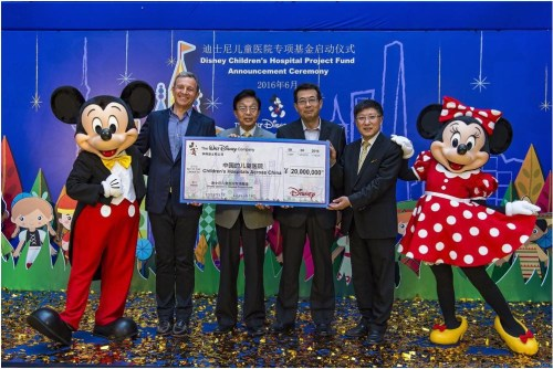 L-R: Mickey Mouse, Chairman and CEO of The Walt Disney Company Bob Iger, Shanghai Charity Foundation Vice Chairperson Song Yi Qiao, China Soong Ching Ling Foundation Vice Chairman Jing Dunquan, Shanghai Children's Medical Center Director Jiang Zhongyi, Minnie Mouse (PRNewsFoto/The Walt Disney)