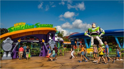 "Little green Aliens from Pixar Animation Studios' Toy Story films pilot toy rocket ships in the Alien Swirling Saucers attraction in Toy Story Land at Disney's Hollywood Studios. The out-of-this-world attraction is inspired by Andy's toy playset from the Pizza Planet restaurant. With multi-colored lighting and sound effects from throughout the galaxies, Walt Disney World guests swirl and whirl in the toy rocket ships while the Aliens try to get captured by ""The Claw"" that hangs overhead. (Matt Stroshane, photographer)"