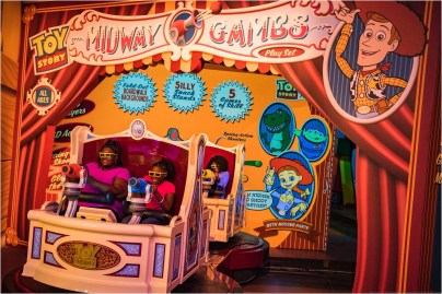 Walt Disney World Resort guests take aim and score big playing the virtual midway games of Toy Story Mania! The 4D attraction takes guests through five unique games, with several surprises along the way. Toy Story Mania! is newly expanded and located in Toy Story Land at Disney's Hollywood Studios. (Matt Stroshane, photographer)