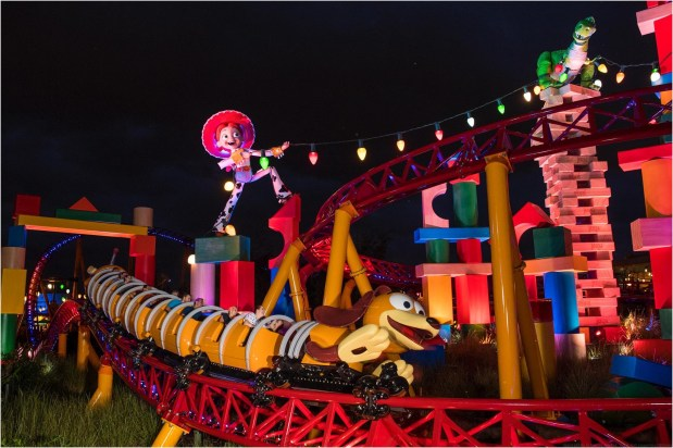 Guests visiting Toy Story Land at Disney's Hollywood Studios at night will discover a whole new experience as colorful lights transform Andy's Backyard. Inside the immersive 11-acre land, guests feel like they are the size of Green Army Men as they are surrounded by oversized toys. Guests can whoosh along on a family-friendly roller coaster, Slinky Dog Dash, take a spin aboard Alien Swirling Saucers and try for the high score on Toy Story Mania! (David Roark, photographer)