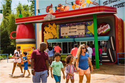 Woody's Lunch Box is a quick-service food and beverage location serving tasty meals and old-fashioned soda floats in Toy Story Land at Disney's Hollywood Studios. The walk-up window – open for breakfast, lunch and dinner – dishes up all sorts of sandwiches and sides that put a spin on classic recipes. Walt Disney World Resort collaborated with Mini Babybel to bring Woody's Lunch Box to life. Inside the 11-acre Toy Story Land, guests can whoosh along on the family-friendly roller coaster, Slinky Dog Dash, take a spin aboard Alien Swirling Saucers and try for the high score on Toy Story Mania! (Matt Stroshane, photographer)