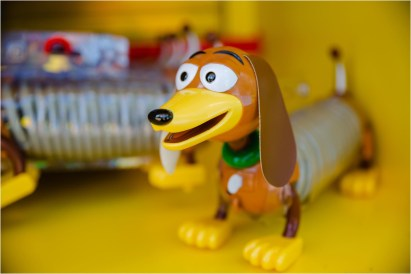 Merchandise inspired by some of the most beloved toys in history is available in Toy Story Land at Disney's Hollywood Studios. After guests take a spin on Alien Swirling Saucers and whoosh around on Slinky Dog Dash, they can take home small-scale replicas of those attractions with Slinky Dog Dash & Dodge Power Boost Set and Alien Swirling Saucers pullback toys. Guests can also wear a Light-Up Slinky Dog, which serves as both a toy and a fashion accessory. T-shirts, toys and more are adorned by Pixar Animation Studios' Toy Story film favorites such as Woody and Buzz Lightyear, which make excellent souvenirs for Walt Disney World Resort guests. (Steven Diaz, photographer)