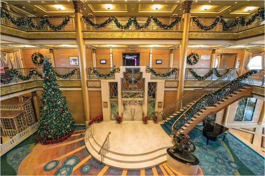 "Holidays are magical aboard the Disney Magic, where the magnificent atrium lobby is transformed into a winter wonderland. In the spirit of holiday cheer, Disney Cruise Line adds sparkle to each ship during Very Merrytime Cruises, with special stem-to-stern holiday events, traditional ""turkey day"" fanfare, Christmas feasts, ""snow flurries"" and New Year's Eve galas. (Matt Stroshane, photographer)"