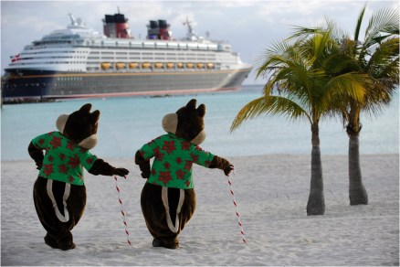 """The holidays take on a tropical flair at Disney's private island in the Bahamas, Castaway Cay, with """"snow flurries,"""" a decked-out Christmas tree, Disney character meet-and-greets and holiday island music. (Kent Phillips, photographer)"""