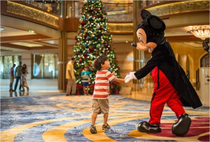 "In the spirit of holiday cheer, Disney Cruise Line adds sparkle to each ship during Very Merrytime Cruises, with Disney characters dressed in festive attire, special stem-to-stern holiday events, traditional ""turkey day"" fanfare, Christmas feasts, ""snow flurries"" and New Year's Eve galas. (Kent Phillips, photographer)"