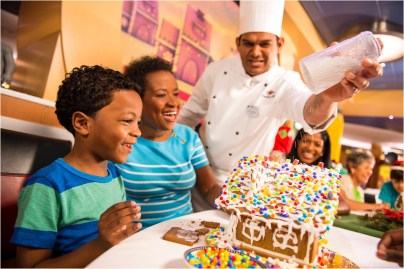 "Holidays are magical aboard the Disney Dream with family holiday activities including building gingerbread houses. In the spirit of holiday cheer, Disney Cruise Line adds sparkle to each ship during Very Merrytime Cruises, with special stem-to-stern holiday events, traditional ""turkey day"" fanfare, Christmas feasts, ""snow flurries"" and New Year's Eve galas. (Kent Phillips, photographer)"