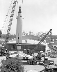TOMORROWLAND UNDER CONSTRUCTION (1955) -Ð Only days before opening day, a crane lifts the ÒRocket to the MoonÓ during construction of Tomorrowland.