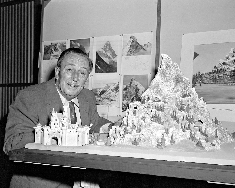 MATTERHORN MODEL (1958) -- Walt Disney reviews a model for the Matterhorn Bobsleds which opened in 1959 at a height of 147 feet.