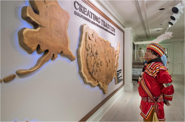"Seminole Indian medicine man and rainmaker, Bobby Henry, visits the Walt Disney World Resort gallery exhibition ""Creating Tradition: Innovation and Change in American Indian Art"" in The American Adventure pavilion at Epcot. The gallery showcases the work of contemporary Native artists alongside artifacts from centuries past. The pieces demonstrate how ancestral American Indian craftsmanship influences modern generations of Native artists. The exhibition features items on loan from the Smithsonian's National Museum of the American Indian, the Museum of Indian Arts and Culture, the Seminole tribe, the Potawatomi tribe and Richard Hammel. (Kent Phillips, photographer)"