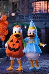 "Donald and Daisy Duck are decked out in their Halloween party-wear in front of the Haunted Mansion at the Magic Kingdom in Lake Buena Vista, Fla. It's all part of the fun that takes place when the Magic Kingdom hosts ""Mickey's Not-So-Scary Halloween Party."" Activities include trick-or-treating, a Halloween parade and Disney's ""Happy HalloWishes"" fireworks show. A separate ticket is required to attend. (Kent Phillips, photographer)"