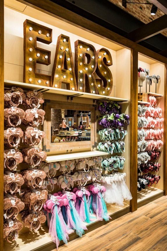 The products are the stars inside the newly reimagined World of Disney at Disney Springs at Walt Disney World Resort in Lake Buena Vista, Fla. This wall of ear headbands demonstrates the store's new bright and whimsical design. World of Disney held an official grand reopening Oct. 27, 2018. (Matt Stroshane, photographer)
