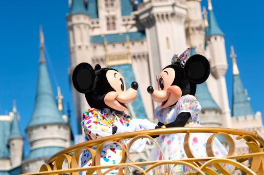 """Mickey Mouse and Minnie Mouse encourage guests to """"get your ears on"""" during the """"Move It! Shake It! MousekeDance It! Street Party"""" at Magic Kingdom Park at Walt Disney World Resort in Lake Buena Vista, Fla."""