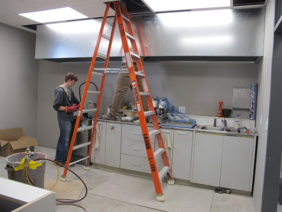Working on the vent hoods in the denture processing and boil out room.