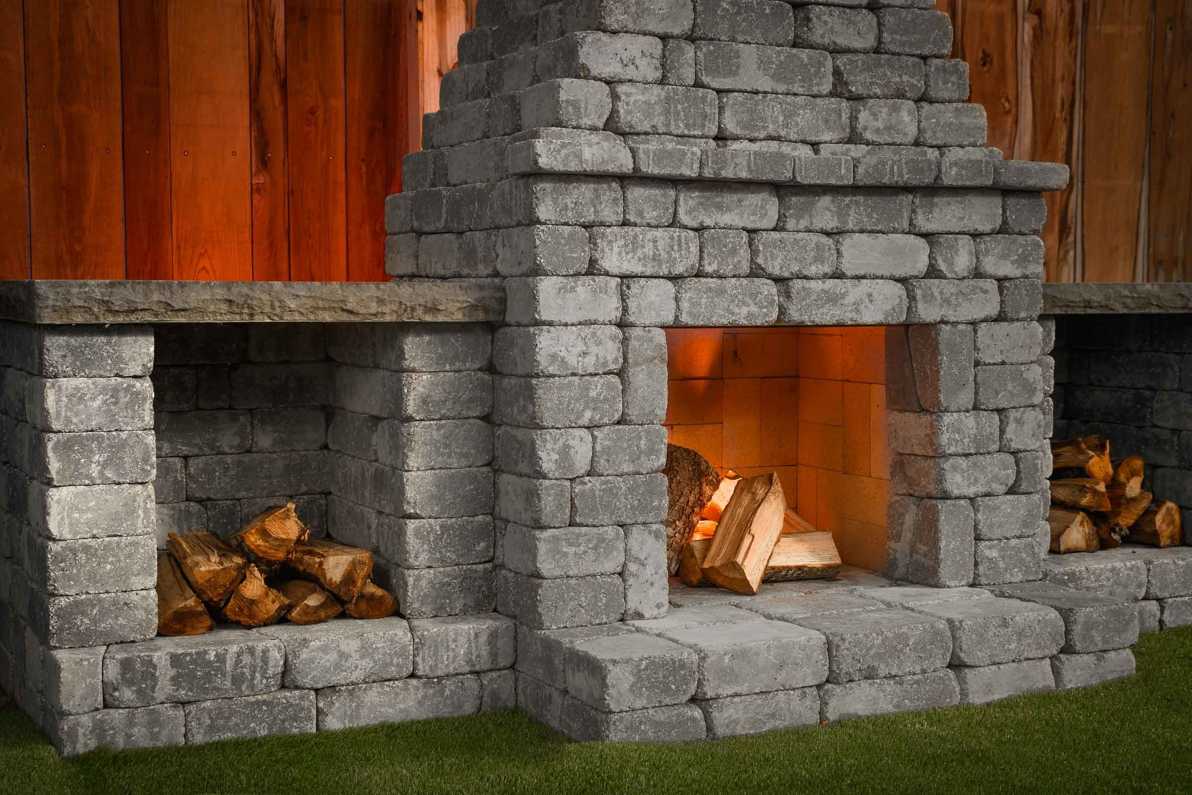 Fremont Fireplace Kit with optional wood storage boxes in Charcoal Blend