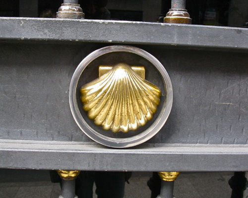 The scallop shell symbol appears on a door in Santiago de Compostela