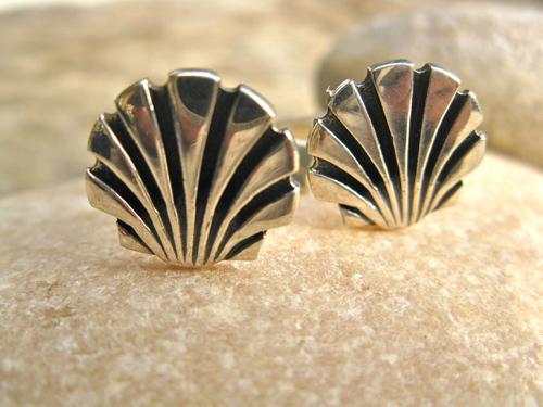 Close-up of classic scallop shell cufflinks
