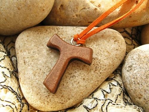 Close-up of the DARK wood Tau cross