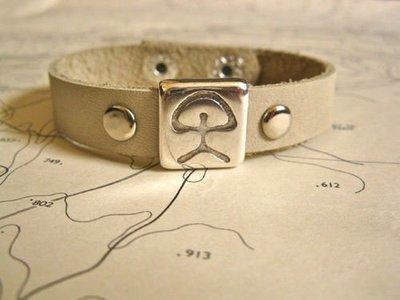 Indalo charm bracelet ~ natural leather strap, ecru