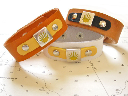 20mm wide leather bracelets featuring the  yellow stylised shell symbol of El Camino de Santiago