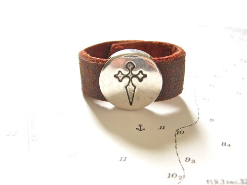 Burgundy-coloured leather ring with St James cross symbol