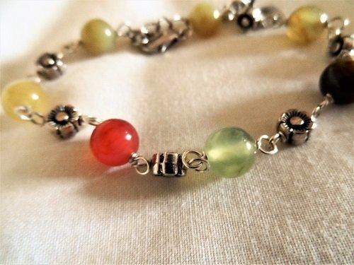 Three coloured jade gemstones