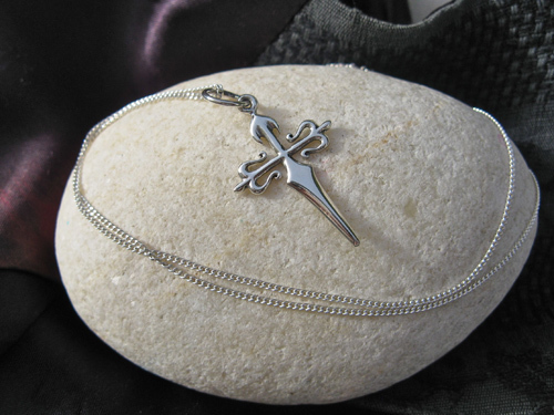 The cross of St James on silver necklace