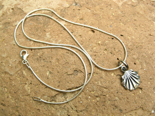 This classic style scallop shell comes on a sterling silver snake chain