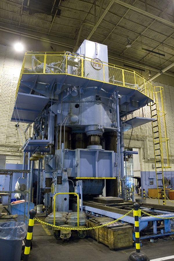 1 – USED HPM 7,000 TON HI-DRAW VERTICAL HYDRAULIC DOWN ACTING FOUR POST GUIDED RAM PRESS WITH 6,300 TON CUSHION C-5364