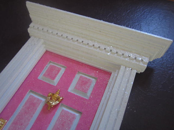 gold knocker on Tooth Fairy door