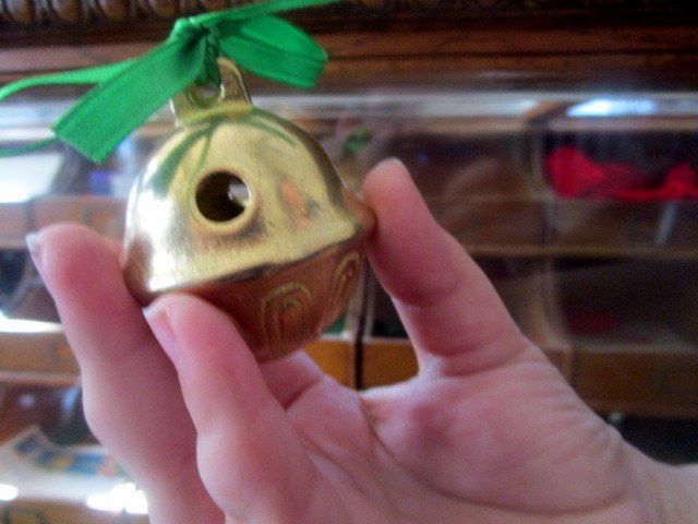 Polar Express Bell held by 10 year old