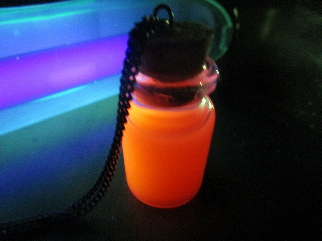 Bottle Emotions glow under black light