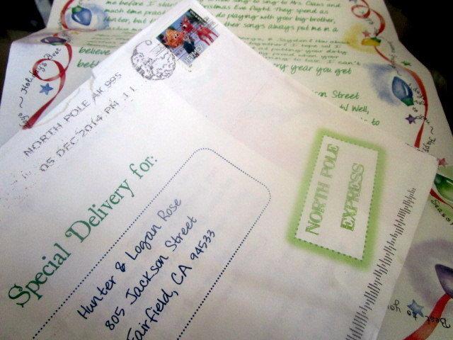 Cursive Santa letter with white envelope