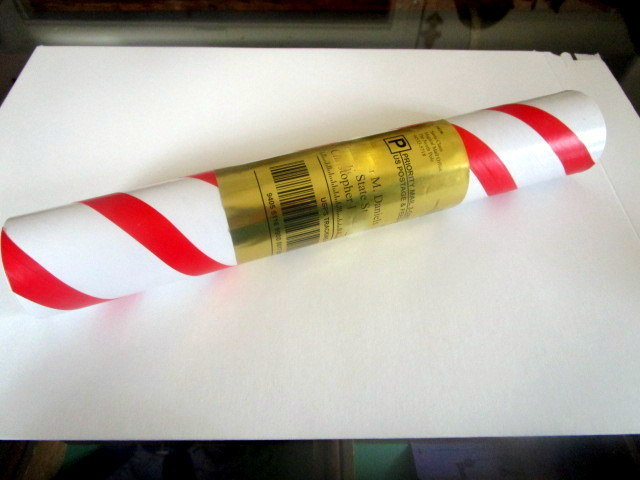 Candy cane tube with gold label