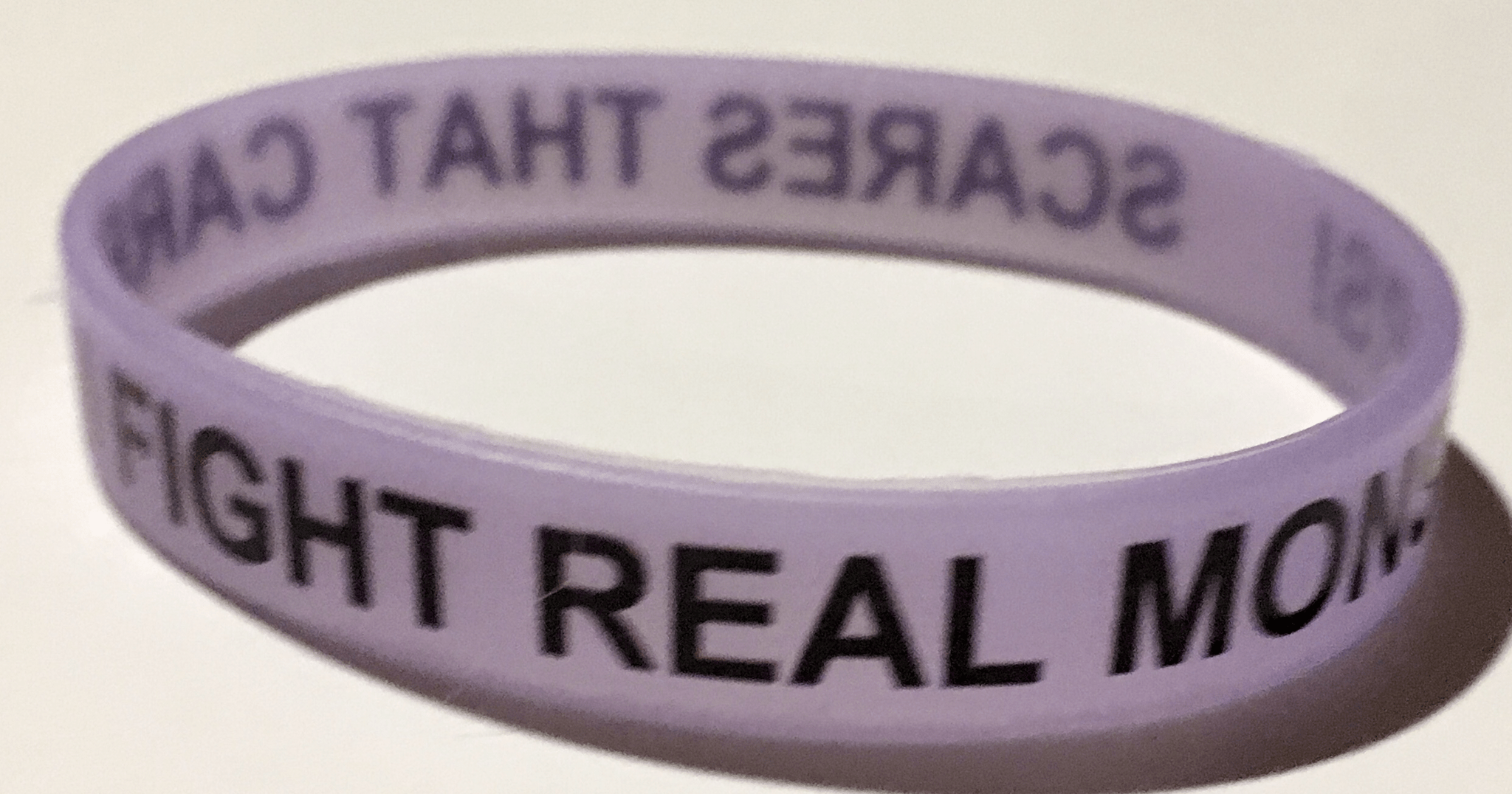 Scares That Care! Glow In The Dark Purple Wristband  00042