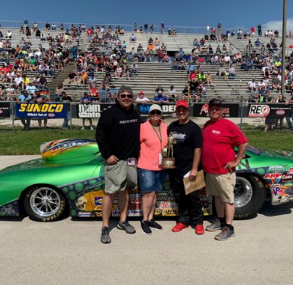 Shawn Carter and family winners circle photo 2019 heartland nationals