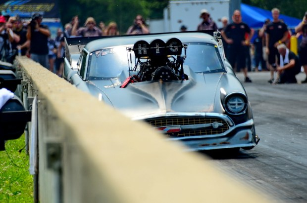 In Saturday's third and final round of Pro Boost qualifying, Larry Higgenbotham came as close as possible to scraping the wall without so much as a scratch on his '57 Chevy.  Higgenbotham won his first round of racing with a holshot against Bill Lutz.