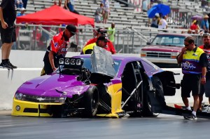 Joey Martin (right) checks out the damage after (ex-)teammate Neal Wantye crashed at Memphis International Raceway last month.