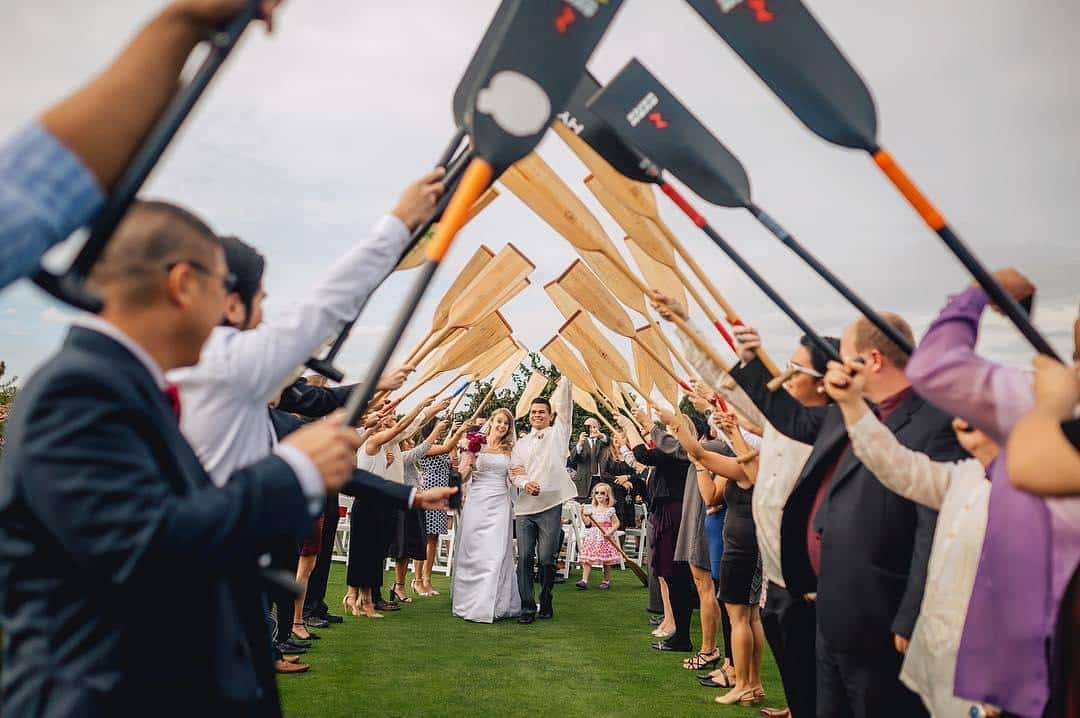 """When you meet on a dragon boat team it obviously means that you exit your ceremony through all of your teammates creating a paddle arch! I loved the personal touches of Christine & Marcial's day!"" @stacielynnphotography To the lovely couple, a big Paddles Up from the dragon boat community! #dragonboat #paddlesup #paddlers #paddlelife #paddle #wedding #marriage #photography"