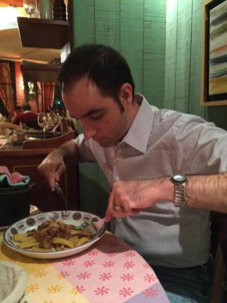 Ian digs into his lamb, last meal in France.