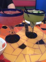 I don't remember what was in the pink margarita, but the green one was Jalepeno Cucumber. Amazing!