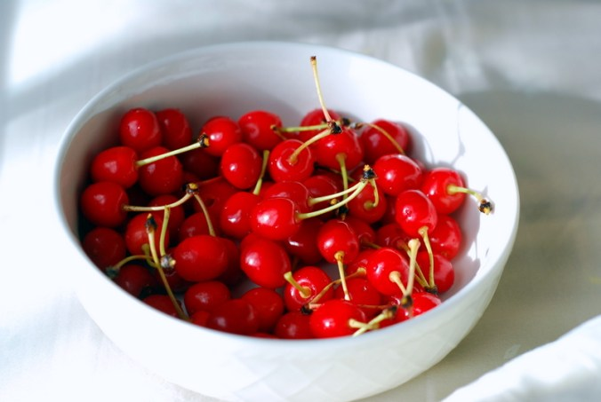 cherries in white bowl 3