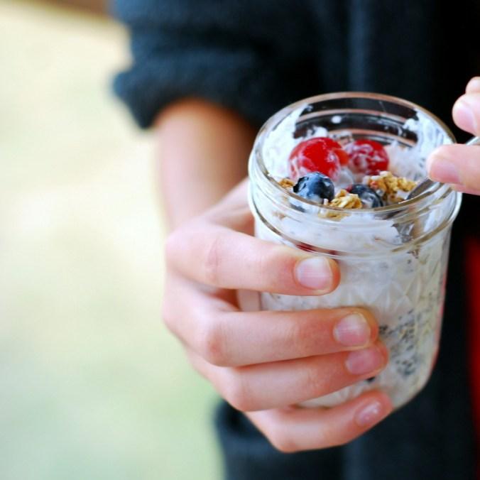 cherry berry breakfast jars in hands 3