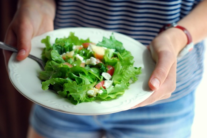 salad in hands
