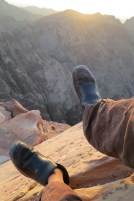 Maaz' feet hanging over cliff.