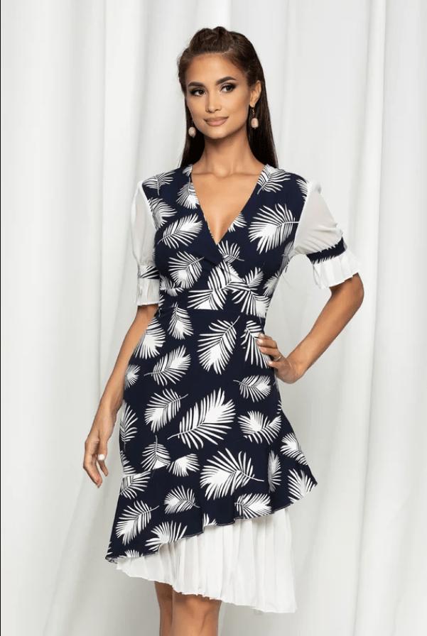 Rochie eleganta bleumarin cu imprimeuri albe si volanase plisate